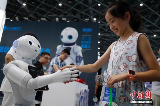"""急速赛车开奖官网网址:如何跟机器人""""抢""""工作?专家:新的分工将形成"""