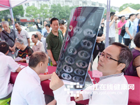 """携手为《中医药法》打气 """"健康直通车""""相约桐乡行"""