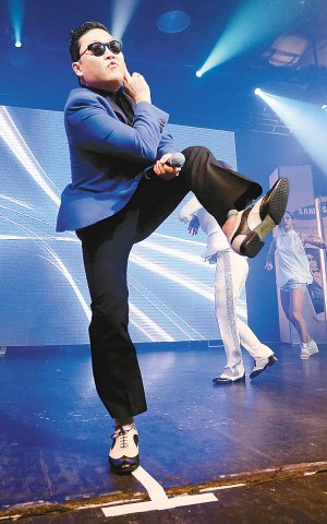韩国艺人Psy (资料图) -鸟叔自降身价上卫视春晚 或与王力宏同台
